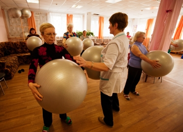 Older women with fit balls undertaking an exercise class
