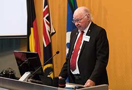 Uncle Lewis O'Brien speaking at a podium