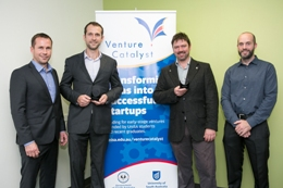 The teams from Vinnovate and Voxiebox in front of Venture Catalyst banner