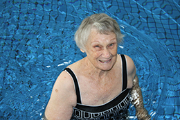 Elderly lady in a pool