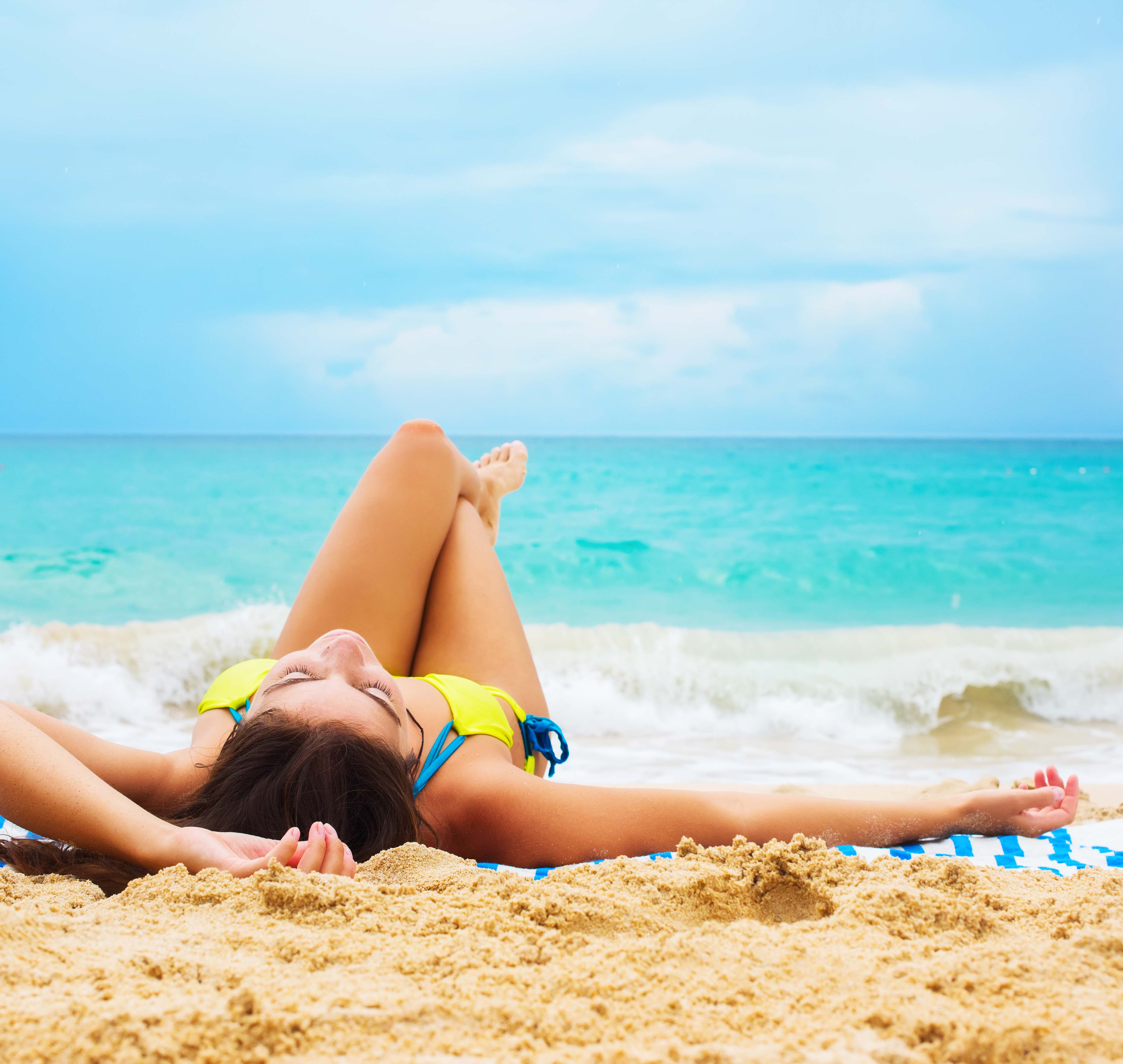 woman tanning on beach