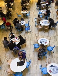 elevated view of people in a open cafe