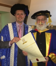 Sir Terry Pratchett recieving his Honorary Doctorate from the University of South Australia's Vice Chancellor Prof David Lloyd