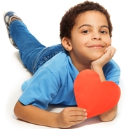 Child holding paper heart