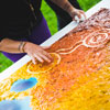 This artwork is one of four pieces created during UniSA's Reconciliation Week celebrations in 2014. Aboriginal artist Chris Ackland worked with UniSA students to create a piece at each metropolitan campus. Together, the four pieces form a larger work depicting South Australia through the use of traditional Aboriginal dot painting and other contemporary techniques. Photo: Juan Photography.