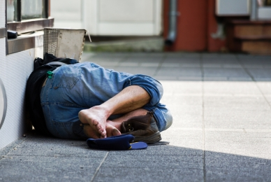 Picture of homeless man sleeping on street
