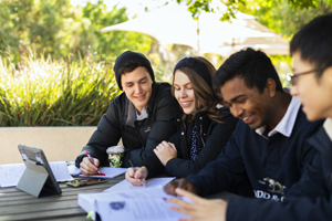 Image of students studying in a campus outdoor space at UniSA Mawson Lakes Campus