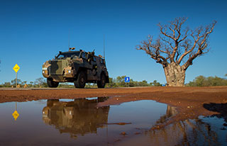 An Australian Army Bushmaster protected mobility vehicle from 1st Brigade drives along the Great Northern Highway during exercise Northern Shield 2016. © Commonwealth of Australia, Department of Defence