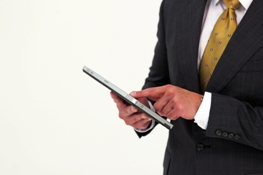 Man in suit holding HP tablet