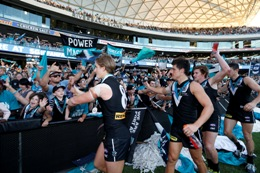 Port Adelaide Football Club players leave field after win