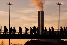 Retrenched workers leaving factory at dusk
