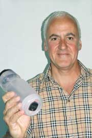 Sandy Walker with his invention, the Safety Bottle Light