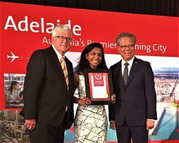 Bachelor of Pharmaceutical Science student Santhni Subramaniam receiving her award
