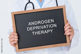 Man holding sign with androgen deprivation therapy written on it