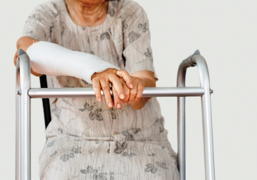 Older woman nursing a broken wrist