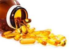 fish oil capsules coming out of vitamin bottle