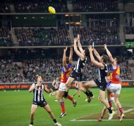 AFL players contesting a mark