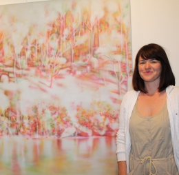 Winner of the Fleurieu Art Prize Fiona Lowry with her landscape painting