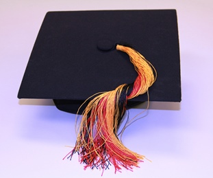 Image of a graduation cap with a tassel of Aboriginal colours