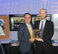 ITR Acting Director, Jeff Kasparian and Senior Research Fellow and GSN Technical Director, Dr David Haley accepting the award at the Wireless Innovation Forum's annual WinnComm Conference.