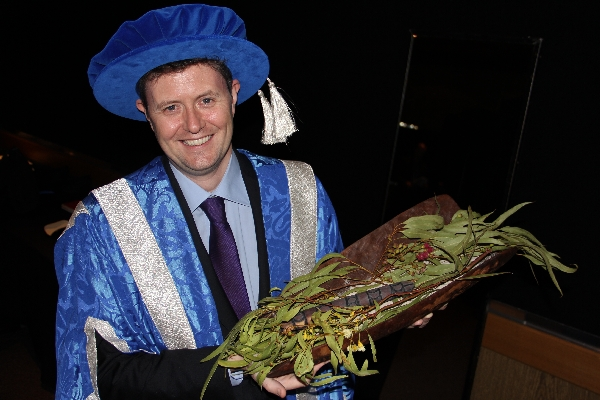 Professor David Lloyd receives a Kaurna welcome to country at the March 2013 graduations