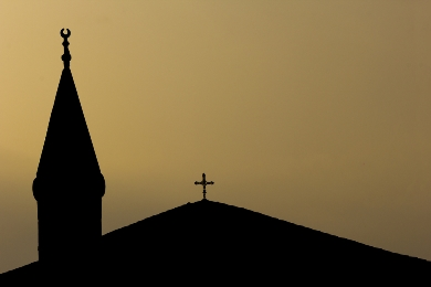 Silhouettes of the steeples of a mosque and a church