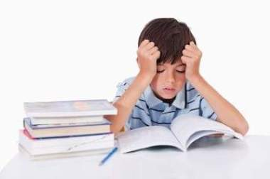 Stock photo of child studying