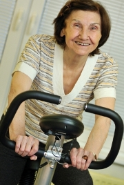 Elderly woman on exercise bike