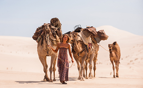 Robyn Davidson leading her camels in the Central Australian desert