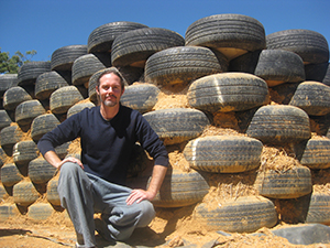 Martin Freney with the tyre wall for Earthship Ironbank