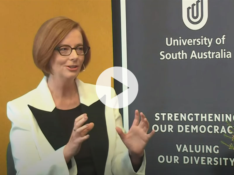 The Hon Julia Gillard AC with the cover of her book Women and Leadership: Real Lives, Real Lessons