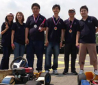 University of South Australia alumni team wearing their medals at Go Karting