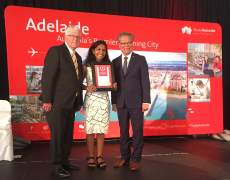 Santhi receiving her award