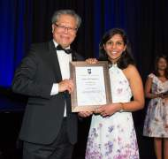 Santhni Subramaniam receiving Sir Eric Neal Award