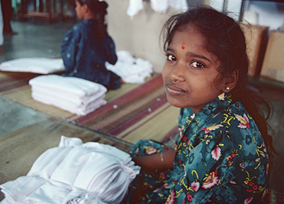 image of girl working in textile factory