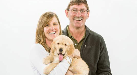 People holding a guide dog pup