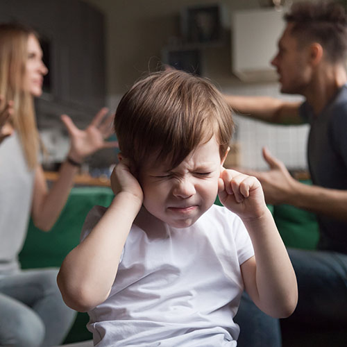 child blocking out parents arguing
