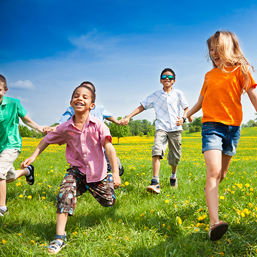 group of children running in a field