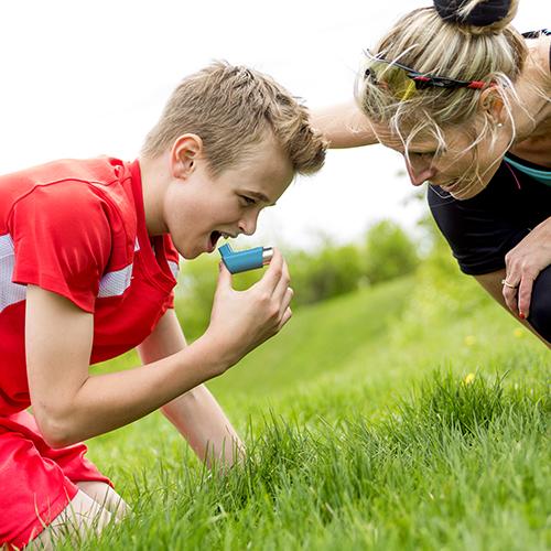 Teenage boy struggling with asthma