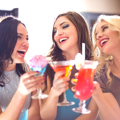 young women drinking cocktails