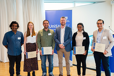 UniSA's Vice Chancellor and President's Scholarship recipients Yusuf Hayat, Ashleigh Hull, Mehmet Yildiz, Chamitha Wijewickrama, Mahmoud Khedher receive their awards from Vice Chancellor Prof David Lloyd (pictured centre).