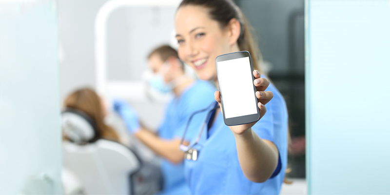 Nurse managing medications on a smartphone