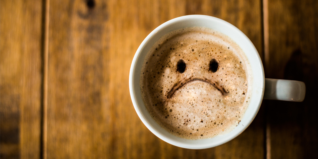 Cup of coffee with a sad face