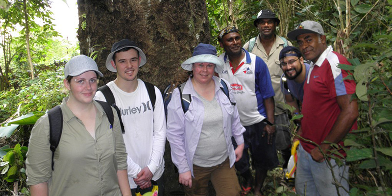 The ma tree survey team comprised of UniSA students, Abaca villagers and NatureFiji-MareqetiViti staff in front of a large ma tree. Photo: Gunnar Keppel.