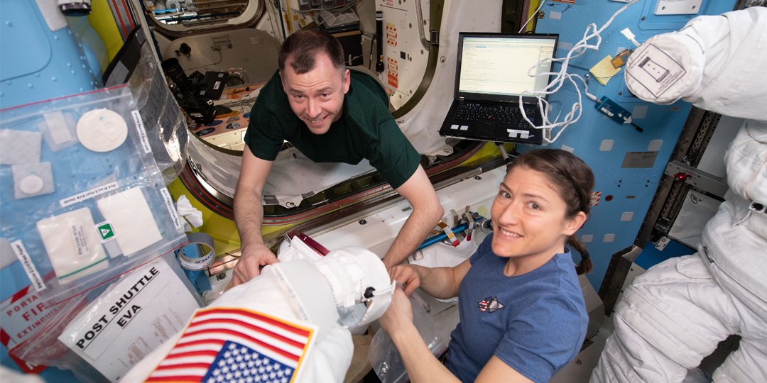 NASA astronauts Nick Hague and Christina Koch work on US spacesuits in the Quest airlock before embarking on a series of spacewalks on the International Space Station. The spacesuits of the future could be embedded with technology developed by UniSA researchers. Image courtesy NASA.