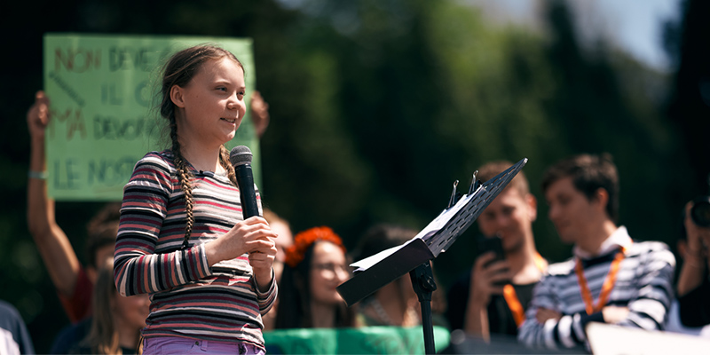 ROME, ITALY - April 19, 2019: Swedish climate activist Greta Thunberg attending Fridays For Future (School Strike for Climate) protest in front of a huge crowd near the Colosseum. Editorial credit: / Shutterstock.com