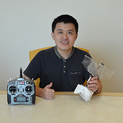 Dr Yao-Wei Chin with the flapping wing drone prototype.
