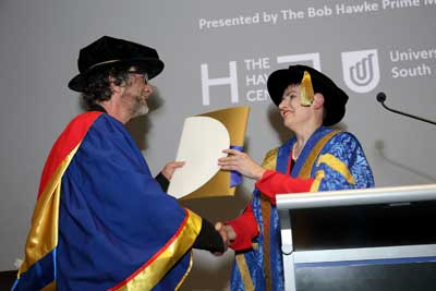 UniSA Chancellor Pauline Carr presenting Neil Gaiman with an Honorary Doctorate.